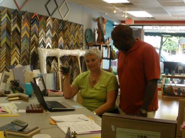 Kelly helps a customer with ideas for framing at Right Angles Framing & Art